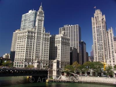 Photograph of The Wrigley Building and Tribune Tower looking over the Michigan Avenue Bridge over the Chicago River